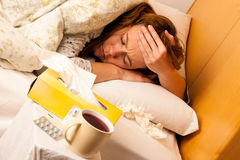 Woman with flu resting in bed Royalty Free Stock Image
