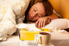 Woman with flu resting in bed Royalty Free Stock Photo