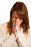 Woman with flu sneezing. Isolated over white background Stock Image