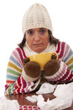 Woman with flu symptoms drinking a hot drink Stock Photography