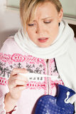 Woman with flu taking her temperature Royalty Free Stock Images