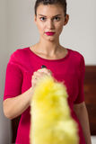 Woman and fluffy dust brush Royalty Free Stock Photo