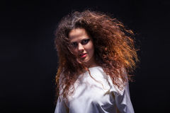 Woman with fluffy hair Royalty Free Stock Images