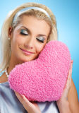 Woman with fluffy heart pillow Royalty Free Stock Image