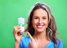 Woman with a fluorescent bulb Royalty Free Stock Photo