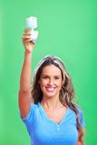 Woman with a fluorescent bulb Royalty Free Stock Images