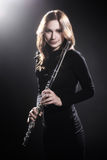 Woman with flute beautiful portrait Royalty Free Stock Photos