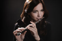 Woman with flute piccolo flutist Stock Photo