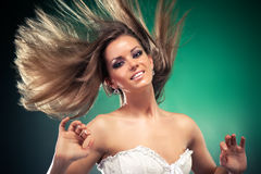 Woman with fluttering hair. On dark green background Royalty Free Stock Images