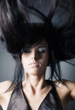Woman with fluttering hair Stock Images