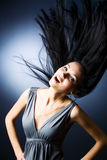 Woman with fluttering hair Stock Photos