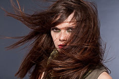 Woman with fluttering hair. On dark background Royalty Free Stock Photos