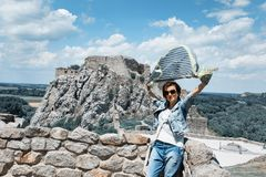 Woman with fluttering scarf on Devin castle royalty free stock photography