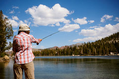 Woman fly fishing Stock Image