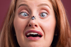 Woman with a fly on her nose Royalty Free Stock Photography