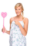 Woman with fly swatter Stock Photos