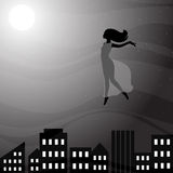Woman flying above night city Royalty Free Stock Photo