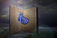 Woman and open book. A woman flying across an open book stock photography