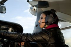Woman flying airplane Stock Photos