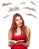 Woman and flying books Stock Photo