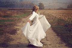 Woman with flying bride dress royalty free stock photo