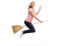 Woman flying on a broom and waving Stock Photography