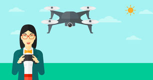 Woman flying drone. An asian woman flying drone with remote control on the background of blue sky vector flat design illustration. Horizontal layout Royalty Free Stock Images