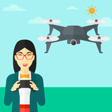 Woman flying drone. An asian woman flying drone with remote control on the background of blue sky vector flat design illustration. Square layout Royalty Free Stock Photos