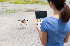 Woman flying the drone Stock Photo