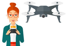 Woman flying drone. A woman flying drone with remote control vector flat design illustration isolated on white background Stock Photography