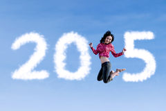Woman flying and forming number 2015 Stock Photography