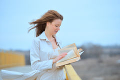Woman with flying hair with book Stock Photo