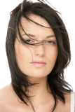 Woman with flying hair squinting eyes Stock Image