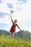 Woman Flying Kite Against Cloudy Sky Stock Photos
