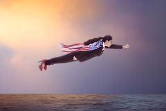 Woman Flying Over The Ocean Royalty Free Stock Photography