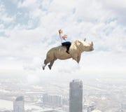Woman flying rhino Royalty Free Stock Photo