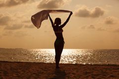 Woman with flying sarong Stock Images