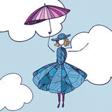 Woman flying through the sky on the umbrella Stock Photos