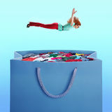 Woman flying to the heap of clothes Stock Photography