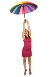 Woman flying with umbrella Royalty Free Stock Photos