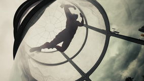 Woman flying in a wind tunnel. Indoor skydiving wind tunnel. Extreme parachuting. Woman flying in a wind tunnel. Woman skydiver doing skydiving in an indoor stock video