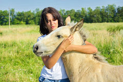 Woman with foal Stock Image
