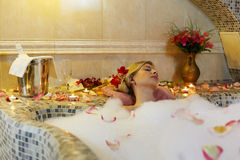 Woman in foam bath Stock Image