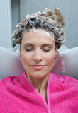 Woman with foam on her hair Stock Images