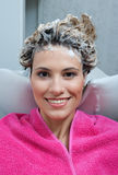 Woman with foam on her hair Stock Photos