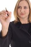 Woman focusing on pen Royalty Free Stock Photo