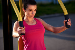 Woman focussed while exercising upper body. Royalty Free Stock Photo