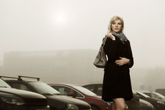 Woman in a foggy morning Royalty Free Stock Image