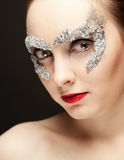 Woman in foil mask Royalty Free Stock Photo