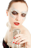 Woman in foil mask with microphone Stock Photography